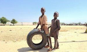 Internally displaced children paly in the Mohammed Goni International Stadium camp in Maiduguri in northeastern Nigeria.