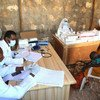 Medical workers at a UN-supported clinic near the Ceel Jaale IDP camp in Belet Weyne, Somalia, attend to a mother and her child.