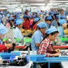 Workers at a footwear manufacturing plant in Cambodia.