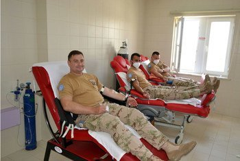 Lt. Col. Ján Hric, Commanding Officer, donates blood with other blue helmets in Sector 4 of the UN Peacekeeping Force in Cyprus (UNFICYP).