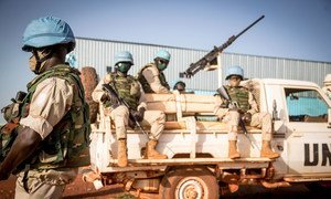 Peacekeepers serving with the UN's Multidimensional Integrated Stabilization Mission in Mali (MINUSMA) wear face masks while on patrol.