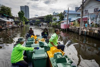 Sanitation workers collect plastic waste from the canals in Bangkok, Thailand's capital city.