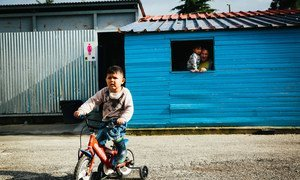 A young boy rides his bicycle inside the Kara Tepe accommodation site, on the Greek island of Lesvos.