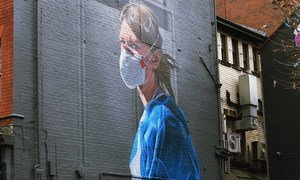 A mural on a wall in Manchester, England, depicts a NHS nurse.
