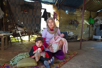 A family in Syria receive food assistance from the World Food Programme.