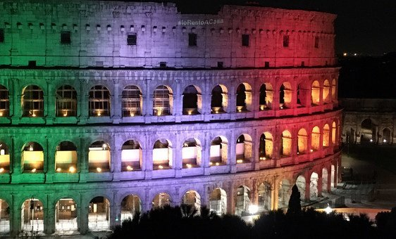 The Colosseum in Rome, Italy, illuminated with the message I stay at home.
