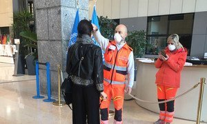 Staff entering the FAO building in Rome are required to have their temperature checked.