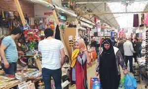 People shop in Azerbaijan's Sederek Market.