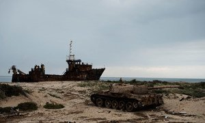 The rusting hulk of a ship and a destroyed armoured vehicle on the beach in Zuwarah, western Libya. (file photo)