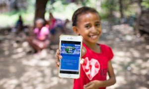 A girl in Timor-Leste shows the online platform she will use to study while her school is closed, due to the new coronavirus pandemic.