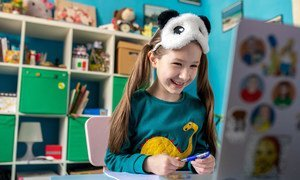 A seven-year-old girl studies online at home in Kyiv, Ukraine, as schools remain closed due to the COVID-19 pandemic.