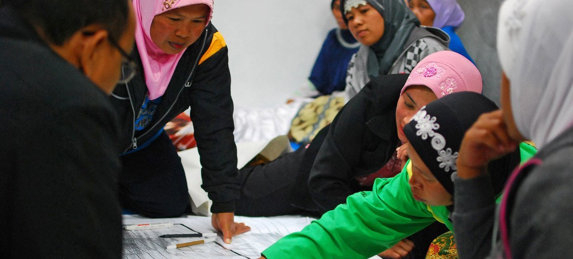 Women play an important role in community discussions after their village Yogyakarta was badly affected by a volcanic eruption.