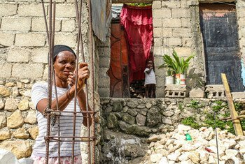 A displaced grandmother and child in Tabarre Issa, Port-au-Pince, Haiti.