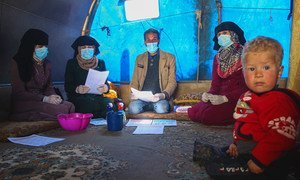 A community COVID-19 awareness session takes place at the Abnaa Mhin IDP camp in northern Idlib Governorate, Syria.
