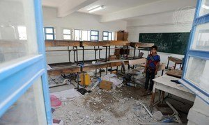 A Palestinian student inspects the damage at a UN school in Gaza. (File)
