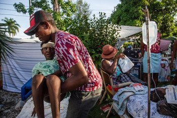 A man is moved to a temporary bed while awaiting medical attention at a hospital in Les Cayes following the earthquake that struck Haiti on 14 August.