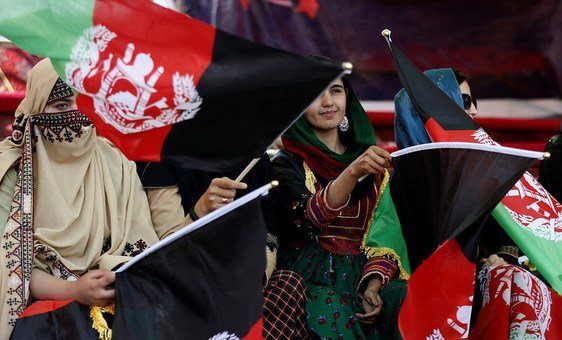 Women demonstrate their support at a political rally in Afghanistan in 2019.