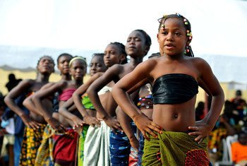 Schoolgirls in Côte d'Ivoire perform as part of activities to raise awareness about peace and human rights.