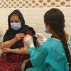 An Afghan refugee is vaccinated against COVID-19 in Rawalpindi in Pakistan.