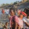Refugiados da Etiópia atravessando fronteira para o Sudão
