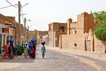 Women walk on the street in Timbuktu, Mali.