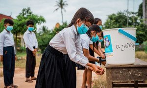 Children at a school in Cambodia wash their hands using a water facility provided by UNICEF.