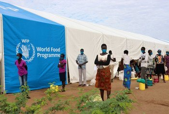 Refugees line up to collect food at a centre in Kakuma camp, in the north of Kenya.