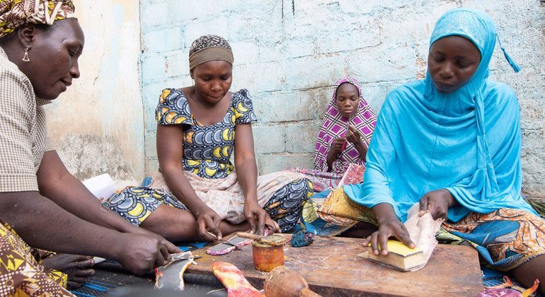 Aminatou Sali (r) is one of 150 Cameroonians who have been taught to produce leather goods by IDP Goods.