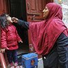 A health worker vaccinates a 4-year-old girl against polio at the door of her house in Bhatti gate area of Lahore Punjab Province, Pakistan.