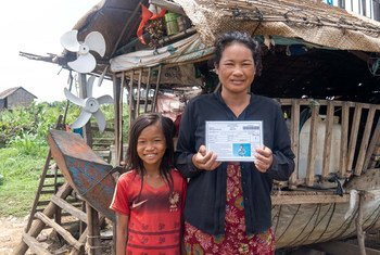 A Cambodian woman shows her government-issued IDPoor card.