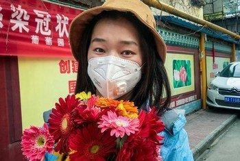 चीन में यूएनडीपी में काम करने वाली एक इंटर्न शुआंगनान वू. उन्हें कोविड-19 का संक्रमण होने के संदेह में अस्पताल में भर्ती कराया गया. अत्यंत सावधानी बरतने की सलाह दी गई है