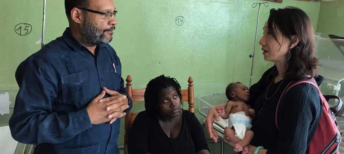 Luwei Pearson (right), Acting Head of the Health Section of UNICEF on COVID-19, is seen here at the Pediatric Ward of Haitian Teaching Hospital-UNICEF Supported Neonatal Project.