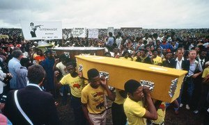 Mourners carry coffins of those who were killed by the South African police on International Day for the Elimination of Racial Discrimination in 1985 at Langa Township in Uitenhage.