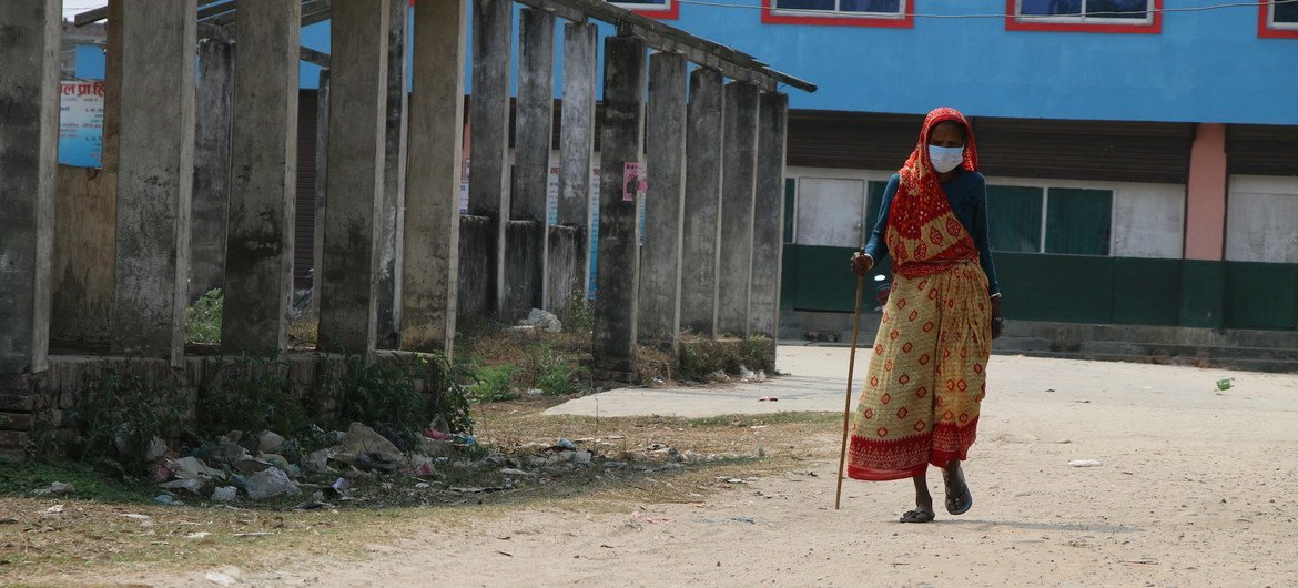 Older women, in particular, face additional challenges and prejudice due to ageist attitudes and discrimination. Pictured here, a 69-year-old woman walks in a village in Nepal.