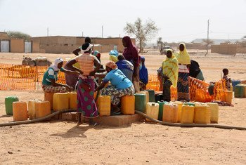 A group of displaced women collect water in the town of Djibo in Burkina Faso.