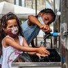 Chefe da Opas pediu uso de máscaras e lavagem de mãos, como estas crianças da Venezuela em um centro de acolhimento em Boa Vista
