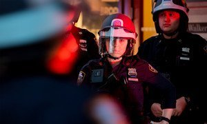 New York City Police Officers look on as protests are under way against racism and police violence after the death of George Floyd.