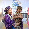 The UN Deputy Secretary-General, Amina Mohammed (centre), interacts with a young girl during a visit to Djibouti in the Horn of Africa in October 2019.