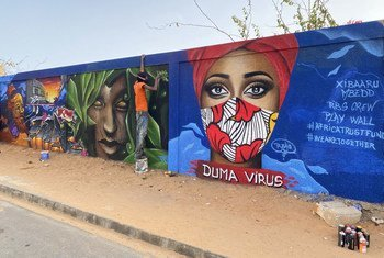 Senegalese artists have painted murals in the capital, Dakar, to raise awareness about COVID-19.