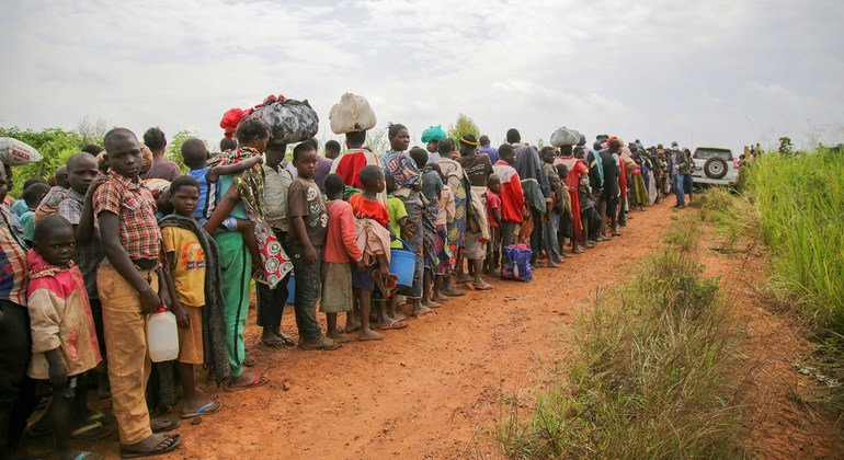 Congolese asylum-seekers line up to undergo security and health screening in Zombo, near the border between Uganda and the Democratic Republic of Congo.
