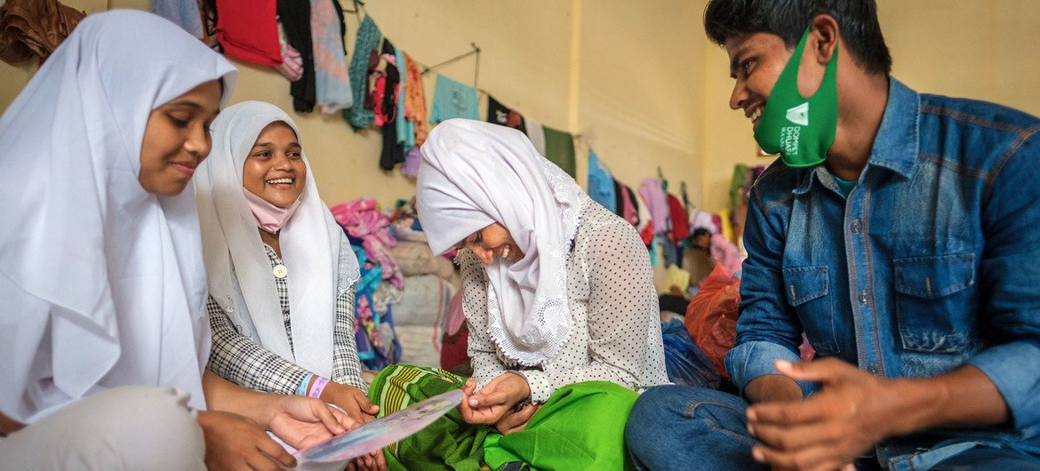 After a seven-month ordeal at sea, a Rohingya refugee from Myanmar reunites with his sister (centre) in Aceh province, Indonesia.