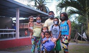 Venezuelan Warao refugee families arrive at a newly opened UN shelter in the Tarumã-Açu neighbourhood of Manaus, northern Brazil.