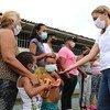 Familias venezolanaas migrantes regresando a su país en la pandemia de COVID.