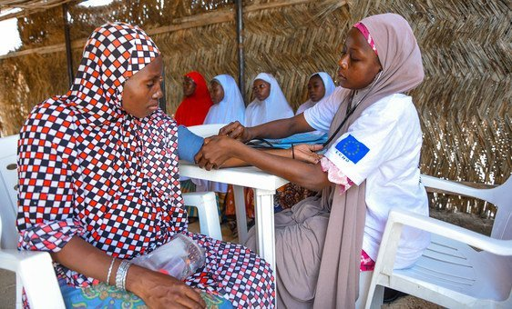 A pregnant woman receives medical care at a mobile health clinic in Nigeria.
