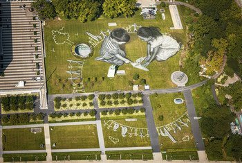 """An aerial view over the UN headquarters in NY shows the giant 11,000 square meters (118,000 sq ft) biodegradable ephemeral fresco """"Work in Progress II""""."""