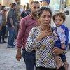 أسرة لاجئة من سوريا في مخيم بارداراش في العراق.