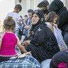 Refugiados sirios que cruzaron a Iraq huyendo de la violencia en un centro de ACNUR.