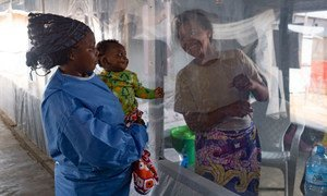 A plastic sheet separates a mother from her son at an Ebola treatment centre in Beni, North Kivu province, Democratic Republic of the Congo (file photo).