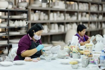 Women migrant workers at a ceramics factory in northern Thailand. As part of the labour force, migrant workers support local businesses and also communities back home.