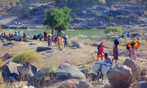 Ethiopian refugees, fleeing clashes in the country's northern Tigray region, cross the border into Hamdayet, Sudan, over the Tekeze river.
